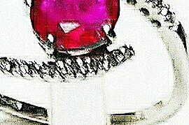 Anello in oro bianco 18 kt. con 1rubino naturale, taglio ovale mm. 6×8 ct.1,35 e 16 diamanti taglio brillante ct. 0,14..