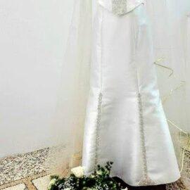 Abito da sposa decorato con tombolo